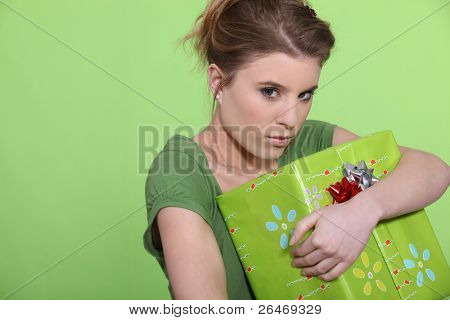 Greedy woman hugging her present all to herself