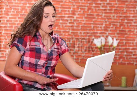 teenage girl doing computer and yawning