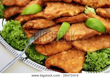 schnitzel served - delicious dinner and vegetable