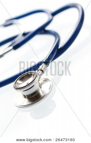 A shallow DOF image of a stethoscope on white background.
