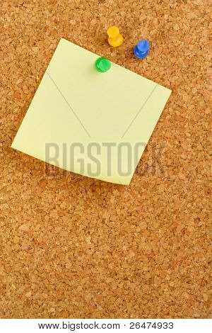 Paper of note with tack on cork noticeboard