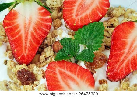 Healthy breakfast - cereal with white yogurt and with strawberries in saucer
