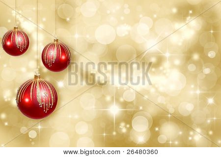 Red Christmas ornaments on a gold background de-focused