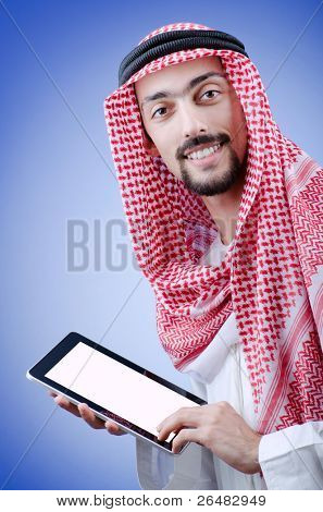 Young arab with tablet computer