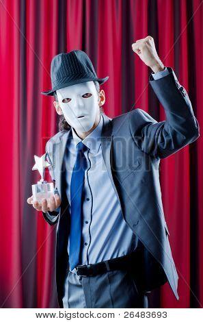 Man receiving award in mask