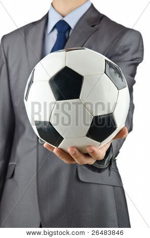 Businessman holding football on white