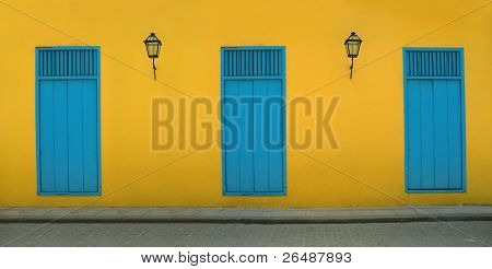 Detail of Old Havana building facade in yellow and blue