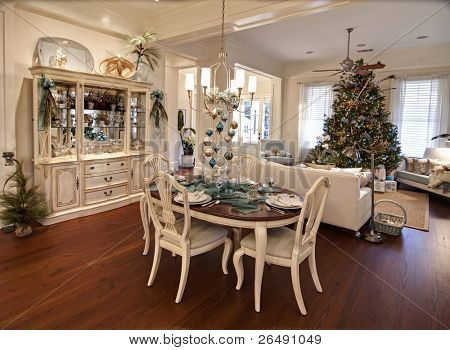 luxury apartment decorated for christmas with table set for dinner