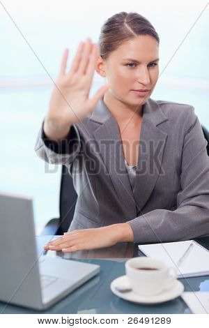 Portrait of a businesswoman refusing a conversation in her office