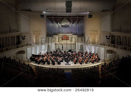 MOSCOW - FEB 26: Audience looks at Symphony Orchestra of Moscow State Conservatory named after P. Tchaikovsky in Tchaikovsky Concert Hall, Feb 26, 2011 in Moscow, Russia. Conductor is Anatoly Levin.