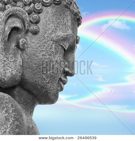 Face of a Buddha with eyes closed in prayer, with a blue sky and double rainbow in reflection in the distance, symbolizing nirvana.  Side view.