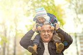 Shot Of A Happy Senior Man Smiling Looking Away His Grandson Hugging Him From Behind Copyspace Relax poster