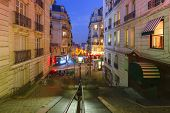 Typical Montmartre Staircase With Old Street Lamp And Entrance To Paris Metro Subway During Evening  poster