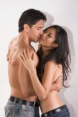 picture of late 20s  - Loving affectionate nude multiethnic heterosexual couple in affectionate sensual kiss - JPG