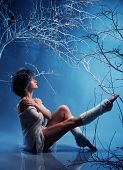 image of leg warmer  - Attractive woman in winter forest - JPG