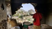 Child inspects their destroyed house due to the war in Yemen... poster