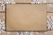 Wooden Brown Christmas Background With Snowflakes And Old Brown Paper With Space. poster