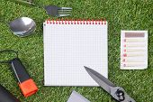 Concept,  Paper Sheet And Items For An Expedition On Green Grass, Close-up poster