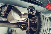 Car Emission Test Theme. Modern Compact Car Muffler Closeup. poster