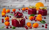 Cranberry Jam In A Glass Jar. The Orange, Kumquat And Fresh Cranberry On A Gray Table poster