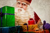 sinterklaas with gifts. Vintage Saint Nicholas in retro style with gifts. Dutch Santa Claus poster