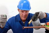 picture of blow torch  - craftsman soldering a copper pipe - JPG