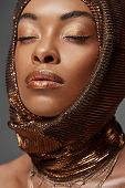 Portrait Of Attractive African American Model With Head Wrap And Eyes Closed Isolated On Grey poster