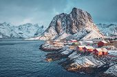 Famous tourist attraction Hamnoy fishing village on Lofoten Islands, Norway with red rorbu houses. W poster