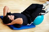 stock photo of gym workout  - man at the gym doing abdominal exercises - JPG