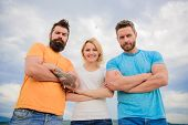 Strength In Unity. Woman And Men Look Confident Sky Background. Threesome Stand Confidently With Fol poster