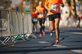 Marathon Running Race, People Feet On Autumn Road. Runners Run Urban Marathon In The The City poster