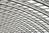 pic of purlin  - Section of the curved reinforced steel roof joists in a conservatory with glass panes in between - JPG