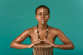 pic of congas  - Portrait of African American woman wearing original tribal themed face - JPG