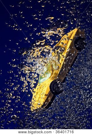 Yellow sportcar accident, going down underwater with air bubbles