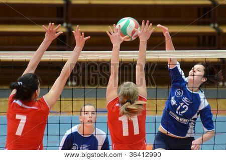 KAPOSVAR, HUNGARY - APRIL 22: Karmen Kovacs (blue 12) in action at the Hungarian I. League volleyball game Kaposvar (blue) vs Budai XI. SE (red), April 22, 2012  in Kaposvar, Hungary.