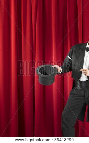 Magician Holding Magic Wand and Top Hat