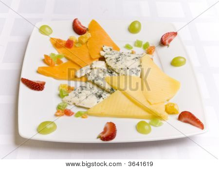 Different Chees With Fruits On White Plate
