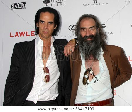 LOS ANGELES - AUG 22:  Nick Cave; Warren Ellis arrives at the