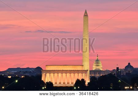 Washington DC city view at a reddish sunrise, including Lincoln Memorial, Monument and Capitol building
