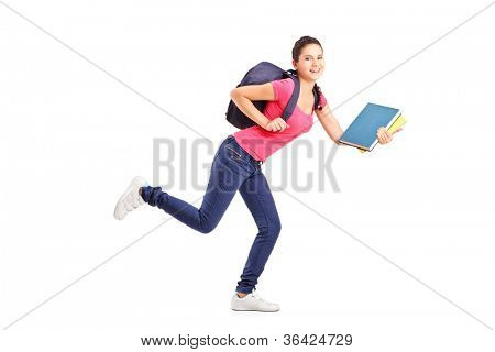 Full length portrait of a college student in a hurry running with notebooks isolated on white background