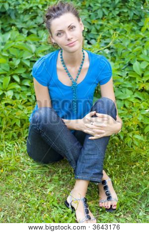 Woman Sit Down On Grass