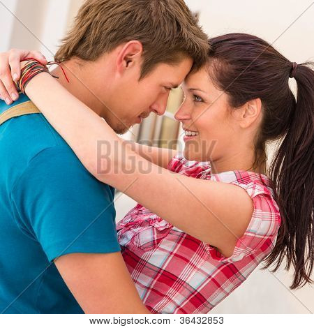 Young loving couple embracing and smiling romance seduction togetherness happy