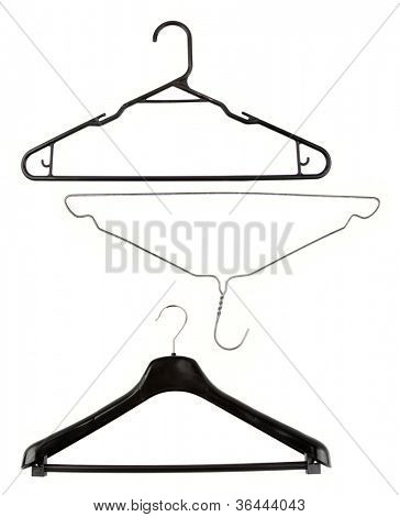 Three coat hangers on plain background