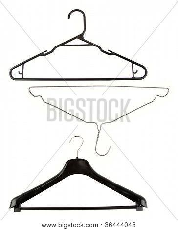 Three coat hangers on plain background