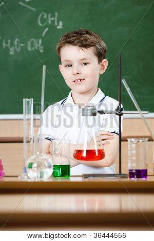 Little chemist holds an experiment