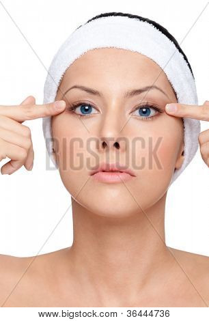 Young woman with flawless skin wants a plastic operation, isolated, white background