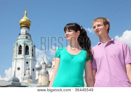 Young couple near Holy Resurrection cathedral in Vologda, Russia