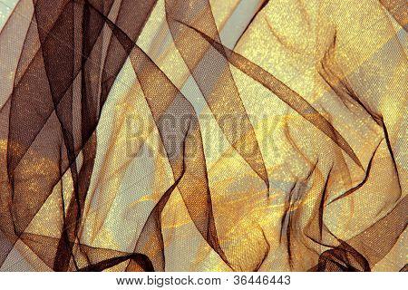 Fondo de tul fantasía en oro y marrón