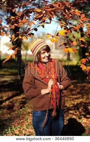 Smiling happy girl in autumn park.