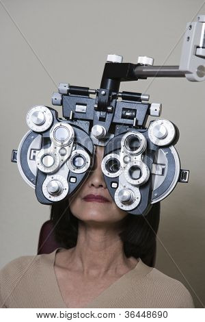 Woman having her vision checked with a Phoropter